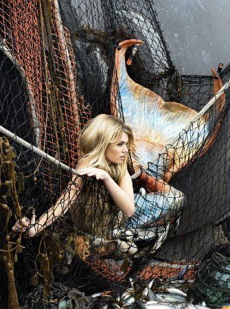 .Tis but a sad sight to see this mermaid tangled in the fishers net...for to not have the sea at her beck and call...she would rather be dead and not live any longer at all. mdh©