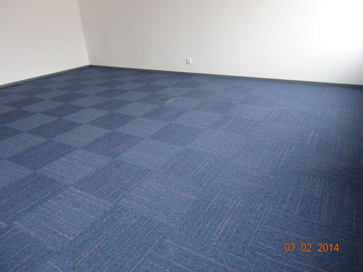 plošný koberec skládaný ze čtverců do šachovnice