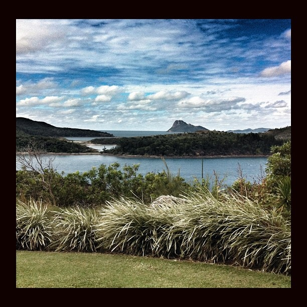 This is the kind of water hazard Captain Cook faced when he discovered Pentacost island - famous peak in the background. View from @hamiltonisland  golf course. The only water hazard we need to worry about today is on the 9th. #return2paradise #seeaustralia #golf
