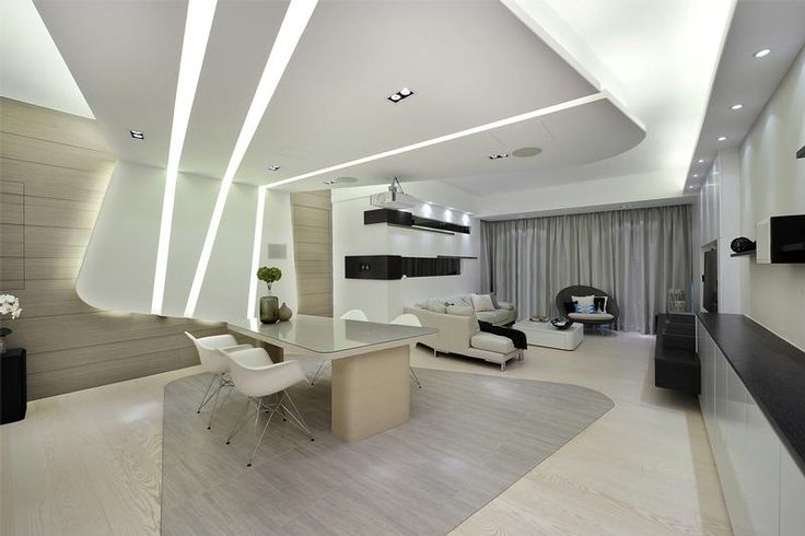 An irregular false ceiling with light troughs extends from the ceiling and goes down to the wall, while a 'shadow' is outlined on the floor.