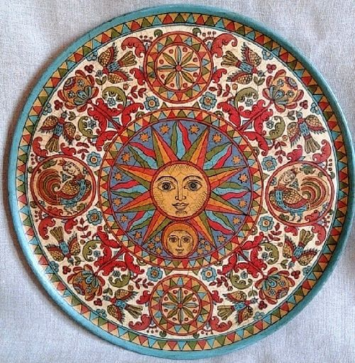 Decorative plate cut from wood. Hand-painted in the style of the Northern Dvina. Surface of plate is artificially aged with cracks effecte-luna