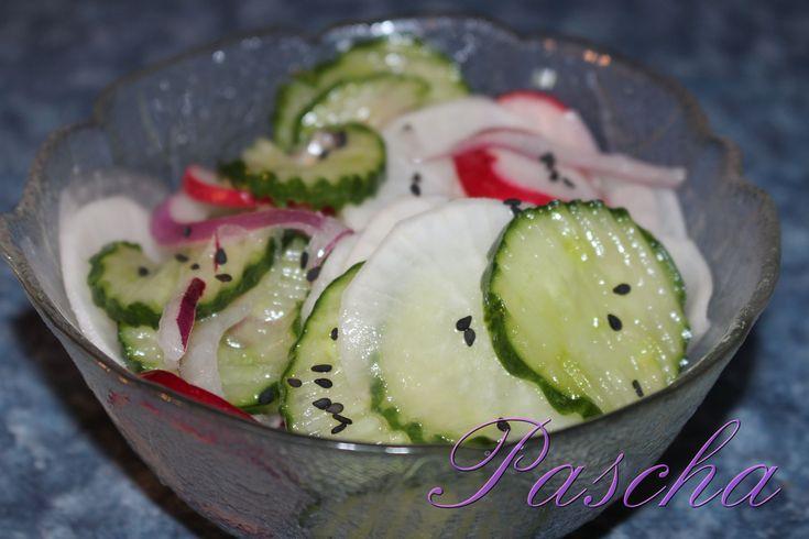 Daikon Cucumber Salad  I used a mandolin slicer to slice all veggies  1 English Cucumber sliced  1 c thinly sliced daikon   2 thin slices of Purple Onion (Optional)  3 Red Radishes thinly sliced  1 tsp Salt  2 Tbsp. Avocado Oil  1 Tbsp. Lemon Juice  ¼ Tbsp. Swerve (Optional)  Black Sesame Seeds (Optional)  Place sliced cucumber, daikon, onion, and red radish into a med bowl  Sprinkle ½ tsp salt over top of sliced veggies let sit 15-20 min  Stir, the veggies should be getting watery…