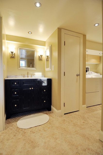 basement bathroom: Combine the utility room and the basement bathroom to make a master bedroom downstairs.