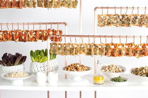 From Pinch Food Design - Taking inspiration from Jennifer's donut wall, we separate pizzas by hanging them from copper hooks. It's a pizza jungle gym. This suspension changes the vantage point of the food. A very effective mingling tool.