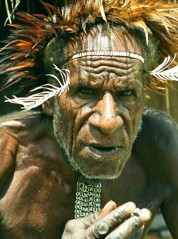 Indonesia | 'Smoking' ~ common in Papua and seen as a social event.  Normally made from homemade herbal mixed.  West Papua | © Monique Vos