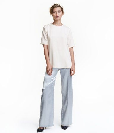 Silver-colored. Wide-leg pants in woven fabric with a sheen. High waist, concealed side zip, and side pockets.