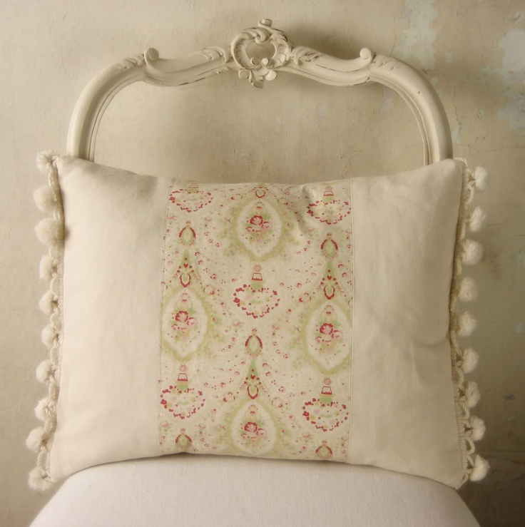 pillow with pompoms on edge.  you could use any fabric in middle