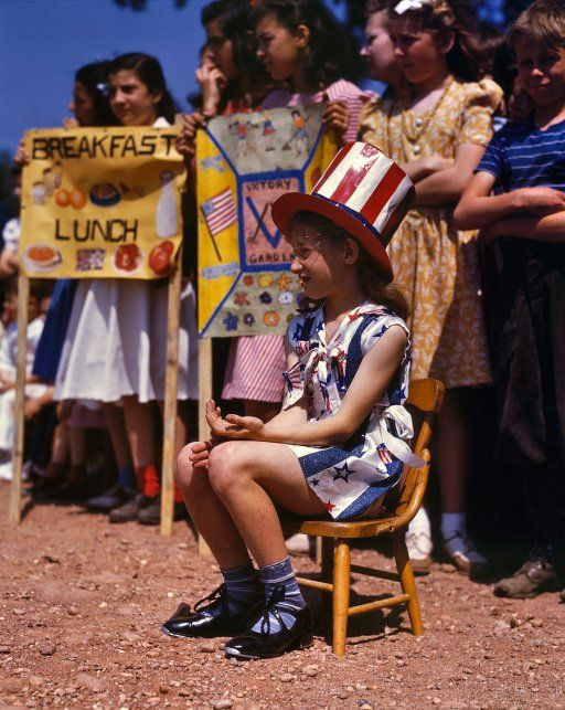 May 1942. Emily Schwak, Queen of the May at the Beecher Street School in Southington, Connecticut, where the children put on a patriotic display