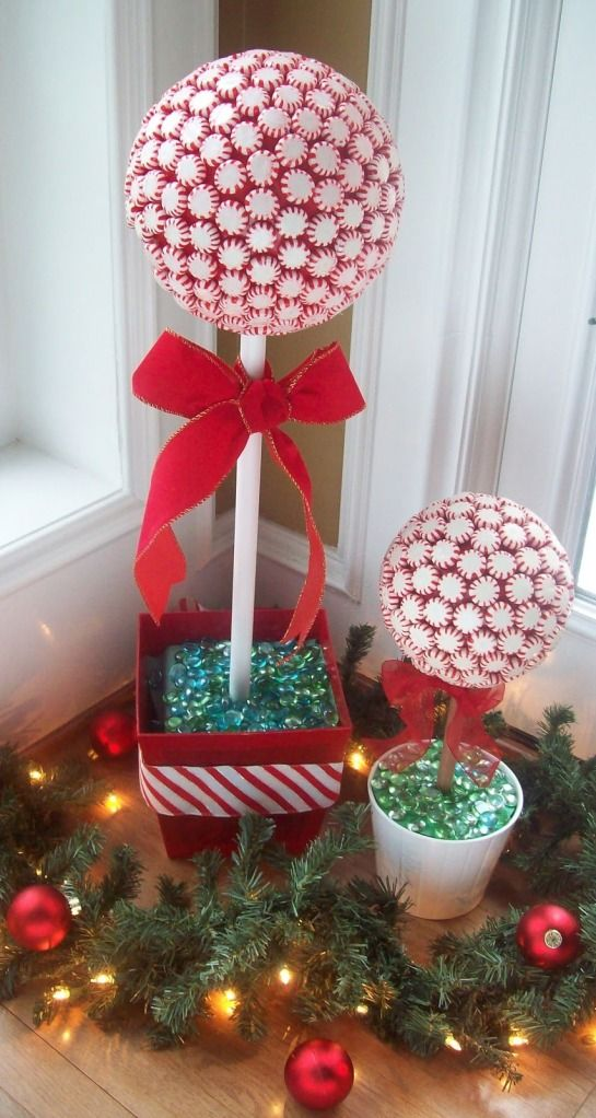 peppermint candy topiaries... cute for parent gifts, but OH SO STICKY! (Bug bait!) Solution: Wrap clear celophane over topiary & tie it with the ribbon. ( Or don't remove the wrappers. ):