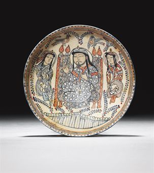 A MINA'I POTTERY BOWL CENTRAL IRAN, CIRCA 1200 Of rounded form on short vertical foot, the interior white ground painted with a central enthroned figure wearing blue dotted robes, flanked by two attendants in robes with scrolling motifs, above them fly two birds and in the foreground runs a stream, foliate motifs in the interstices, the rim with a band of blue stylised kufic and green scrolls, the exterior with a band of black pseudo-inscription between red lines, intact