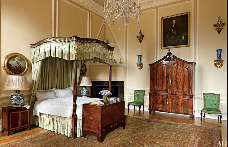 At Easton Neston, in Northamptonshire, England—the 1702 house by Nicholas Hawksmoor owned by fashion designer Leon Max, who restored it with Ptolemy Dean Architects and Spencer-Churchill Designs—the Tapestry Bedroom features a George III mahogany bed with a custom-printed linen canopy; the carpet is a 19th-century Sultanabad.