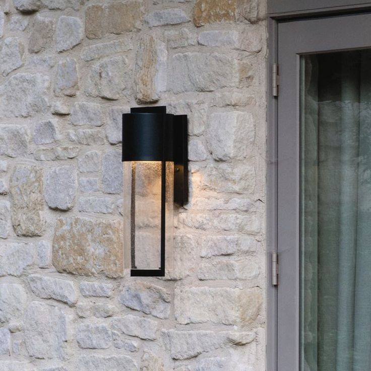 Bedeck your outdoors with the beautiful wall lantern. it is constructed from cast aluminum and seeded glass shade in a scandinavian style that enhances its looks and durability. this wall lantern has a black finish that lends a stylish appeal to the rest of your decor and settings. it accommodates different wattage of bulbs according to its various sizes. this wall lantern works on 120 volts power. it is ideal to be fixed on the walls of your front porch. this exceptionally gorgeous wall…