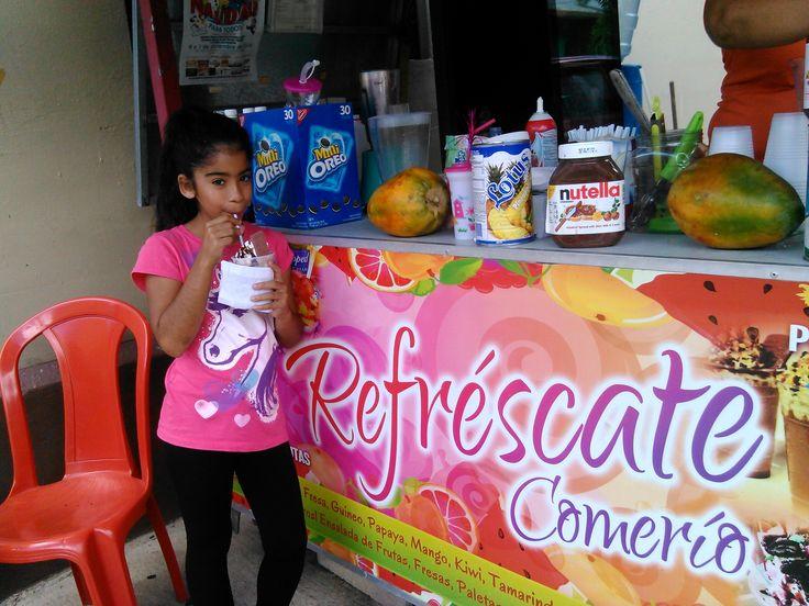 "Enjoy a delicious smoothie at ""Refréscate Comerío"" in front Econo Supermarket."