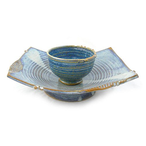 Asian-Inspired Stoneware Pedestal Serving Dish in French Blue. Ideal for an endless variety of serving ideas, the set includes a curved pedestal dish and separate rice/dip bowl, which may be used in the center of the dish or set aside. Sculpted from high-fired ceramic stoneware, the serving dish is durable, chip-resistant, lead-free, food-safe, and oven/microwave/dishwasher safe. Handmade in North Carolina.