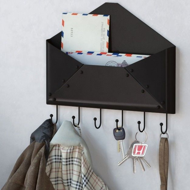 The cutest wall-mount key rack and mail holder. | 17 Cheap Things To Keep Your Apartment Organized