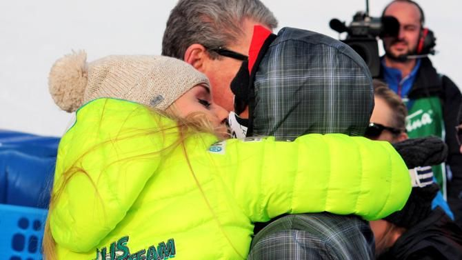 Tiger Woods and Lindsey Vonn, left, exchange a kiss in the finish area of an alpine ski, women's World Cup super-G, in Cortina d'Ampezzo, Italy, Monday, Jan. 19, 2015. Lindsey Vonn won a super-G Monday for her record 63rd World Cup victory and celebrated with an embrace from a surprise visitor, boyfriend Tiger Woods. The American broke Annemarie Moser-Proell's 35-year-old record of 62 World Cup wins with a flawless run down the Olympia delle Tofane course, finishing 0.85 ahead of ...