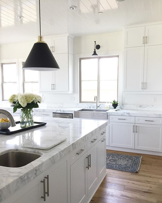 BECKI OWENS- Estillo Project kitchen install! Black Rejuvenation cone pendants, marble counters, white cabinetry, blue One Kings Lane kitchen runner, shiplap ceiling.