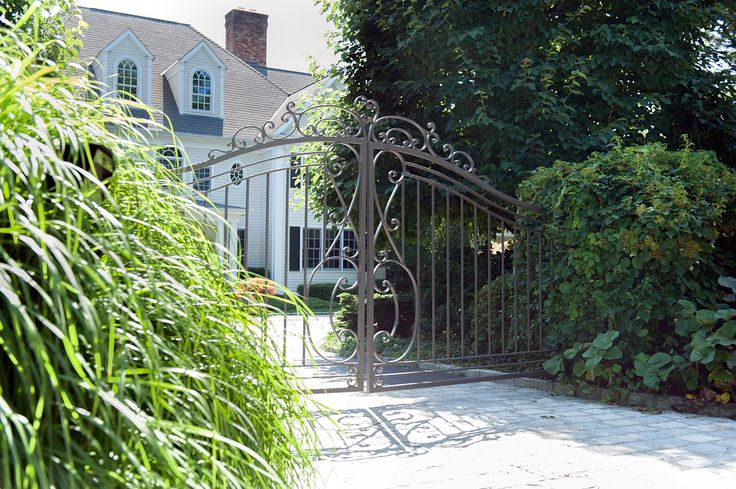 Streamlined classic design wrought-iron automatic driveway gate. Gate designed and installed by Tri State Gate in Bedford Hills, New York.