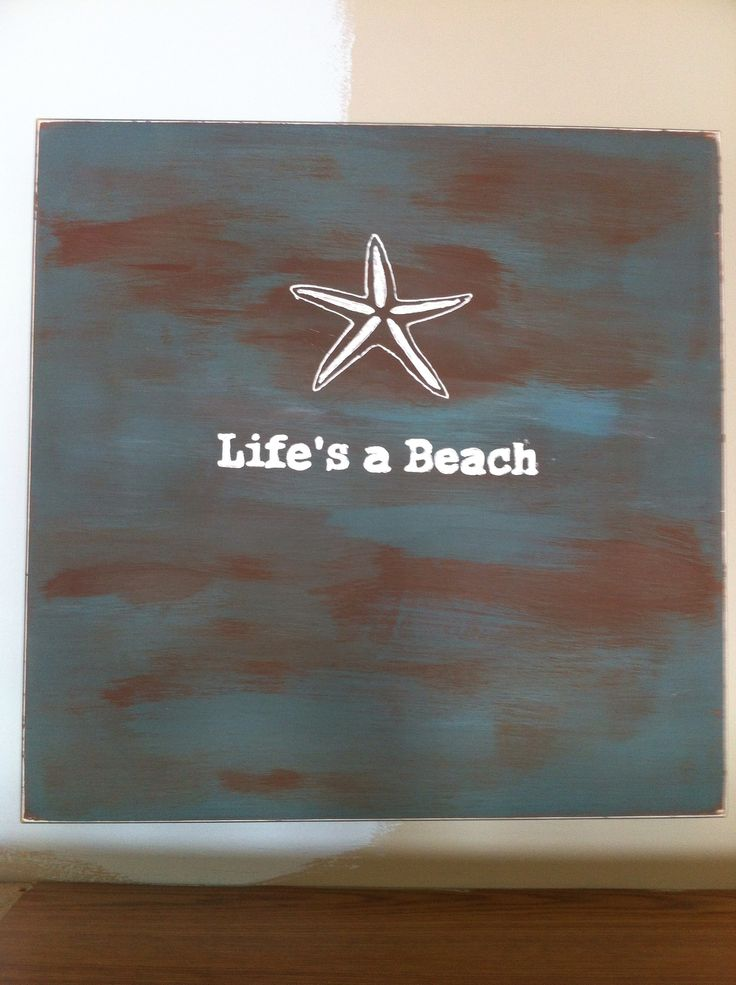 I painted over an existing canvas with brown and blue chalk paint them added the graphic & starfish.