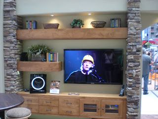 Stone entertainment center. I like the big shelves and I think I like that it's off-center. JC