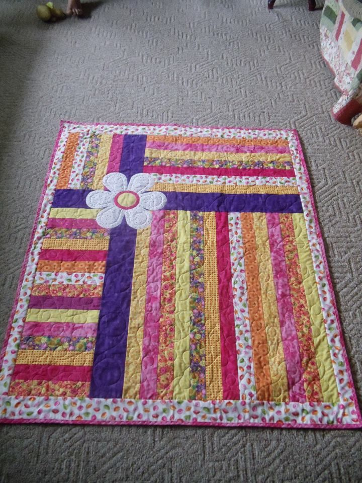 Stripped quilt to use up any scrapes of material. I really like the color combinations. Got the photo from my cousin of this quilt she made.