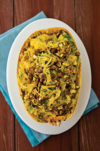 PISTACHIO LEMON SPAGHETTI SQUASH 1 large spaghetti squash  3 tablespoons olive oil, divided  1 shallot, minced  1 clove garlic, minced  2 tablespoons minced parsley  1 teaspoon lemon zest  1 tablespoon lemon juice  Salt and pepper, to taste  1/4 cup diced pistachios