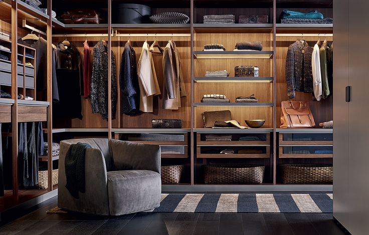 Senzafine walk-in closet in walnut c. melamine with lateral side frame. Shelves in fumé glass with piombo painted aluminium frame and built-in led lamps.