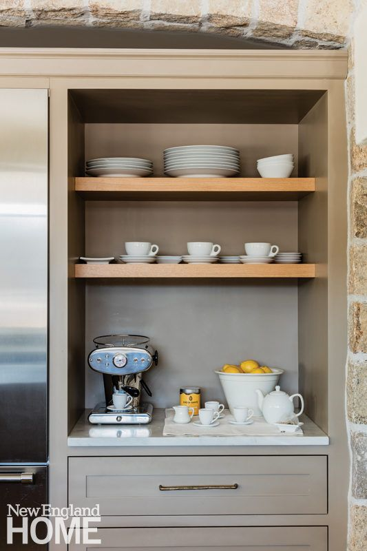 Built In Shelves By Michael Humphries Woodworking Provide Storage And Display Space In This Beautiful Neutral Kitchen With Stone Accents