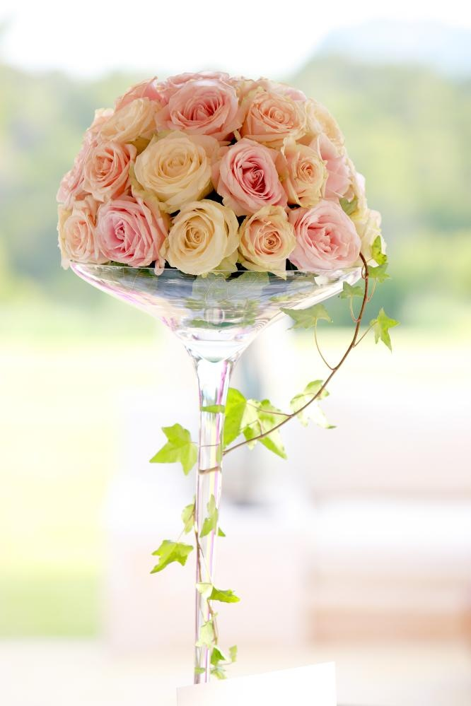 Rose centrepieces in tall martini glasses