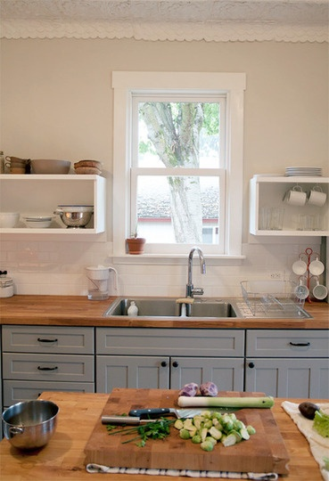Grey cabinets on the bottom + open shelves on the top + butcher block counter top (And this links to a debate on double bowl sink pros/cons)
