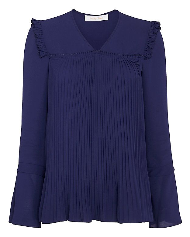 See By Chloe Pleated Ruffle Blouse: Accordion pleats fall below the yoke seam at front and back of this blouse. Ruffle detail at shoulders of long sleeves with layered flare cuff. In electric blue. Fabric: 100% polyester Made in Portugal. Model Measurements: Height 5'10 1/2; Waist 24 ; ...