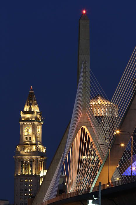 Boston skyline photography from New England and Boston based fine art photographer Juergen Roth showing landmarks such as the Custom House of Boston, Leonard P. Zakim Bunker Hill Memorial Bridge and One International Place captured on a twilight night in September 2013.