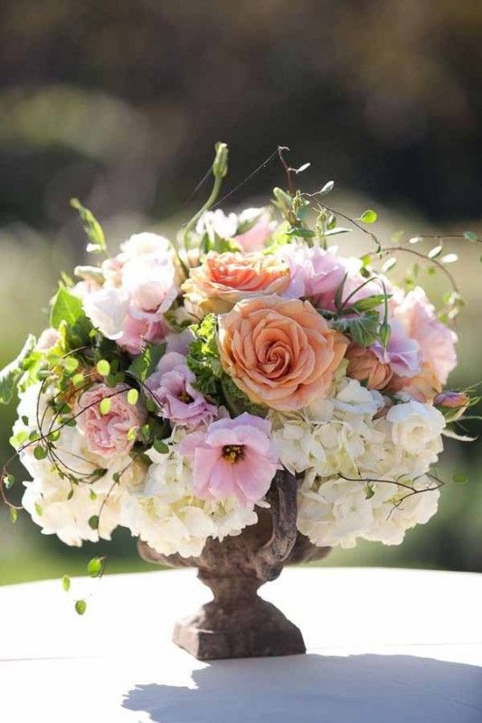 urn with peach, pink and white flowers
