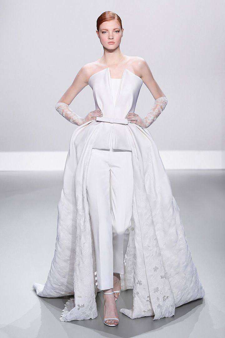 Ralph & Russo - Haute Couture Collection S/S14 - Look 12: White silk gazar peplum gown with embellished open work on train and silk crepe trousers