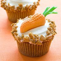 Carrot Cupcakes & Make fun carrot decorations for your cupcakes using molded Circus Peanuts and green Twizzlers.