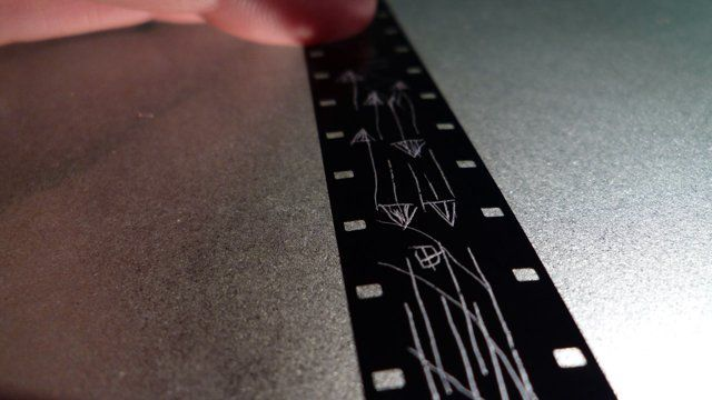 Scratch is an experimental animation that attempts to visualize the sounds and patterns produced by the turntable.  Hand scratched line animation on 16mm leader, transferred to HD.