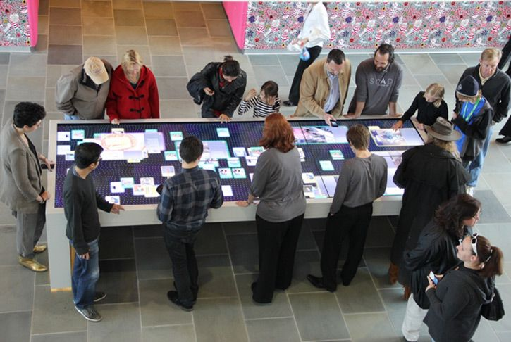 Pentagram designs an interactive table for SCAD Museum of Art to promote SCAD programs in a communal experience.