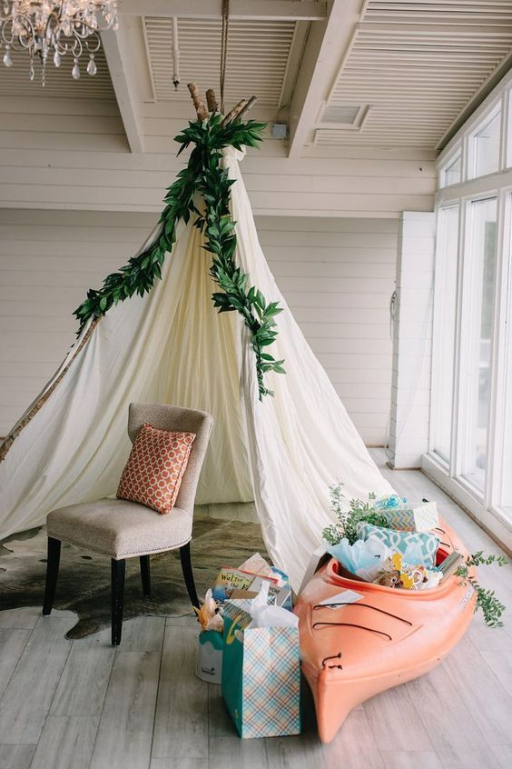 Go for a chic rustic look and create a teepee with a white sheet, long, thin branches for support and greenery. | Cute Teepees | Trending Now: Rustic Camping Themed Baby Shower