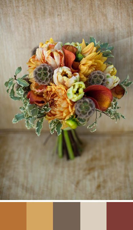 I like the cream, gold and coral hues in this bouquet. Earthtones don't have to be dull.