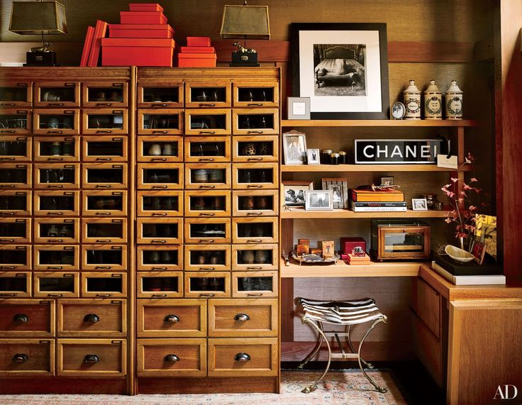 At event designer and decorator Ken Fulk's San Francisco home, the walk-in closet—formerly a guest room—features vintage shoe-display cabinets from London.