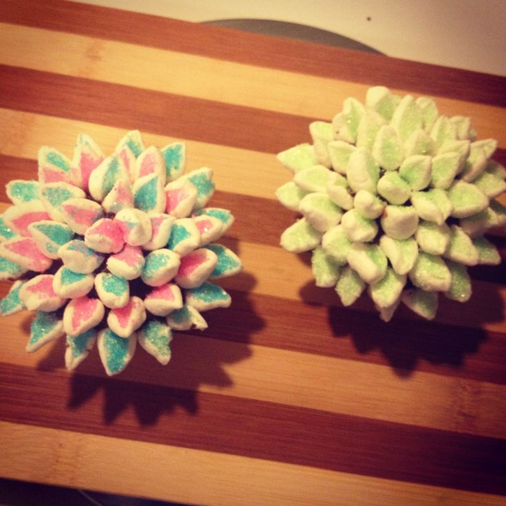 I made these flower cupcakes.. Cut mini marshmallows diagonal and dip them in sanding sugar or sprinkles.. Which ever you like... Place them around cupcake starting from outside In :) they are so easy and fun.