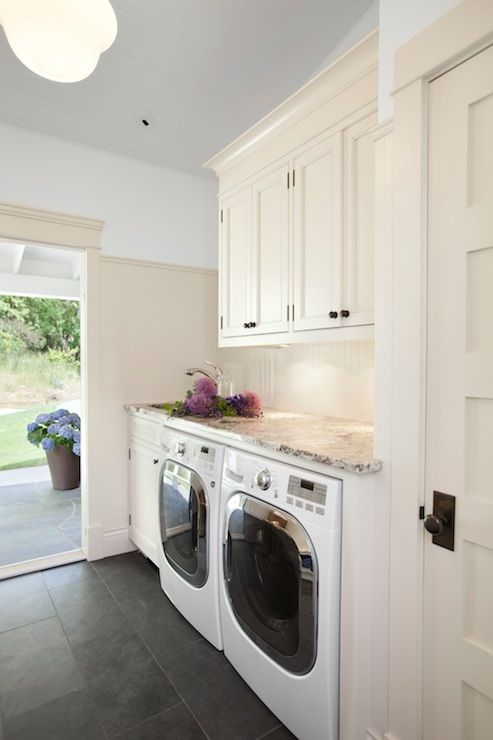 Jodi Foster - laundry/mud rooms - laundry room storage, laundry room cabinets, laundry room cabinetry, gray tiled floors, gray floor tile, n...