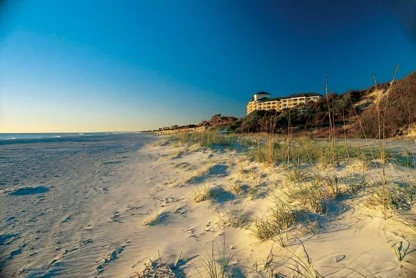 Amelia Island Located north of Jacksonville, Amelia Island edges coastal Georgia. Take the Amelia River Cruise for a scenic tour of the barrier island — beachgoers will love the surf, sea oats and sand dunes. Find sharks' teeth along the shore and at the pier at Fort Clinch State Park, and sample true southern hospitality with a stay at one of Amelia Island Plantation's tranquil villas.