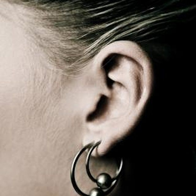 how to clean infected ear piercing