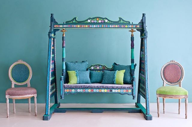 This Jhoola, a traditional swing used in Pakistan and India, was inspired by Pakistani truck art. I started with a base of Aubusson Blue and embellished from there. The details and flowers are picked out in individual colours. The whole swing was then waxed in Clear Chalk Paint® Wax, with some added metallic elements using my Gilding Wax. The cushions and seat pad are made from my Coloured Linen collection.