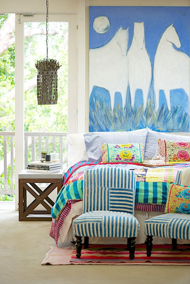 Unique and fun colorful bedroom with great art and patchwork details (the duvet is made with Lisa Corti fabrics.)