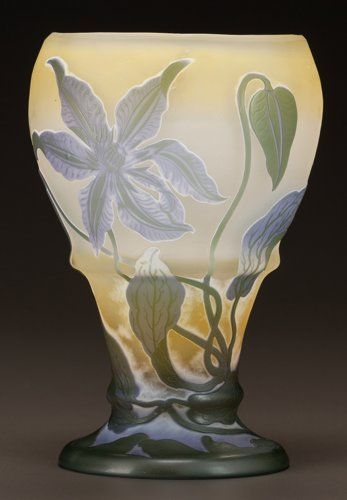 E.GALLE(1846-1904)___ overlay glass floral footed vase .Circa 1900