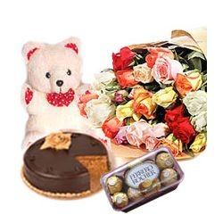 1/5 kg Black Forest Cake and 12 Red Roses with Small Teddy and 16 Pcs Ferrero Rocher Chocolates  (We deliver only Freshly Baked Cakes. Bakeries make ready the fresh baked Cake only by 11 AM.Thus all orders of Cake can only be delivered after noon time.)
