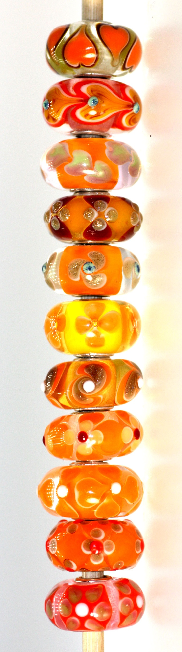 The NEW Orange Uniques are a treat for the eye.  Orange is hot for 2012.  http://www.trollbeadsgallery.com/categories/All-Unique-Beads/Glass-Unique-Beads/