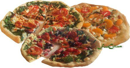 The designer trio of pizzas ... a sesame seed crust from www.FoodCult.com .  Toppings include spinach and feta, mandarine orange segments, and blueberries and strawberry slices.  Break the rules.  Have fun with your #pizza !